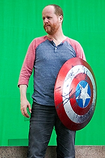 Joss Whedon – with the shield of Captain Amercia